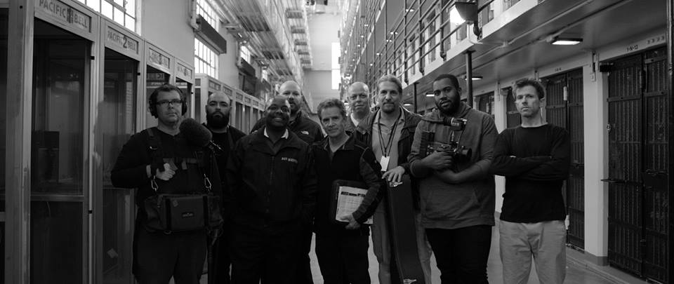 "Director Rocky Capella (center) and some of the incredible ""Don't Shoot! I'm the Guitar Man"" crew inside San Quentin."